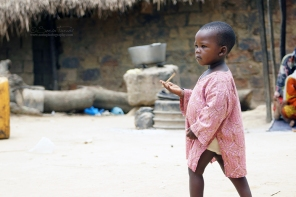 Zongo, DRC. The child of a refugee from Bangui, the capital city of the Central African Republic, playing in the crowded yard of the local Imam. The Imam provides assistance and support to the Muslim refugees that made their way to Zongo and live with host families.
