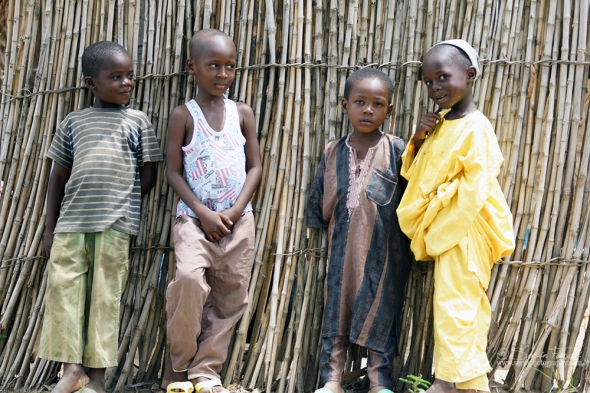 Zongo, DRC. It was a big crowd around the local Imam's house. It was the Friday morning time for prayer and his yard was full with refugees from Central African Republic that Imam helps. These four boys were eager to pose for me. They picked the place and the poses and I just took the photos.